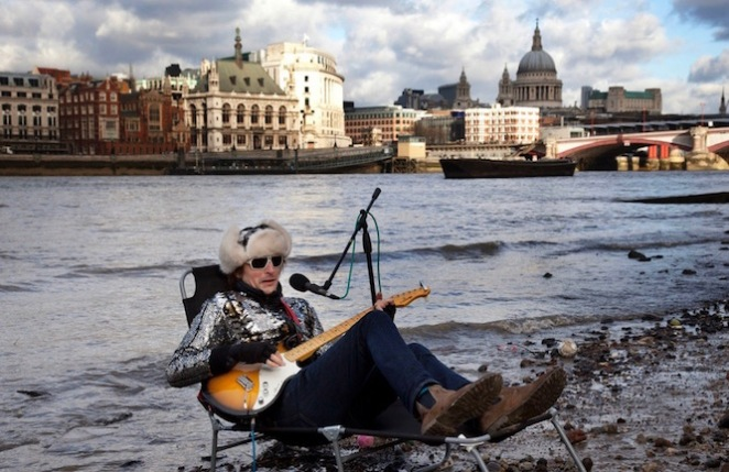 UK - London - Busker 'Flame Proof Moth' performs on the edge of the River Thames on the Southbank