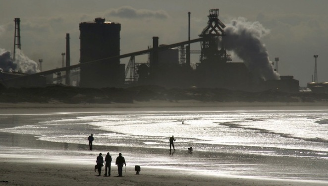 Picture of Redcar steel works.  Looking along the coast from Redcar beach, towards the steelworks and South Gare at mouth of the River Tees.  The steelworks at Redcar has the largest blast furnace in Europe and dominates this stretch of coastline.
