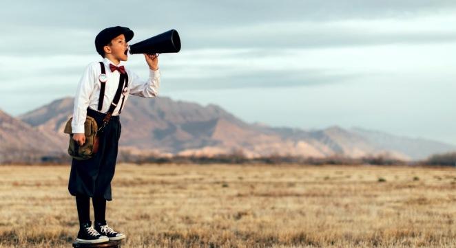 Old Fashioned News Boy Yelling Through Megaphone